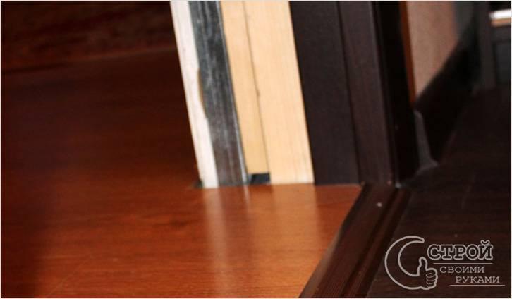 Укладка ламината около дверной коробки